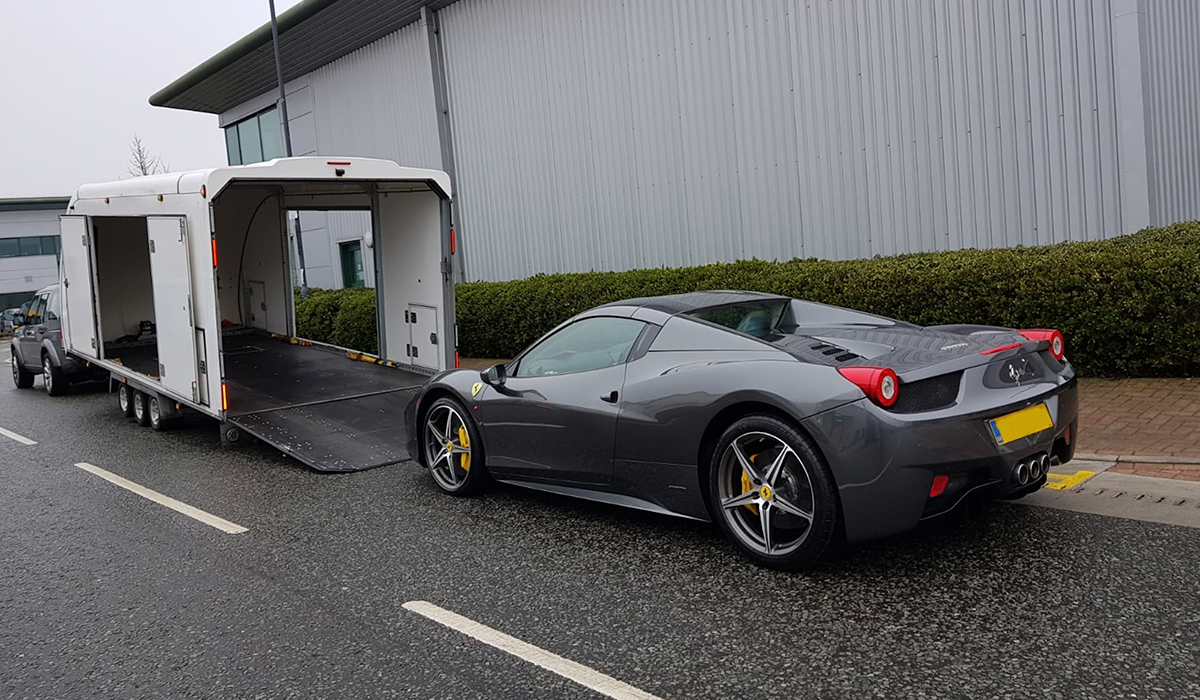 BSM Covered Enclosed Car Transport London England Gray Racing Ferrari