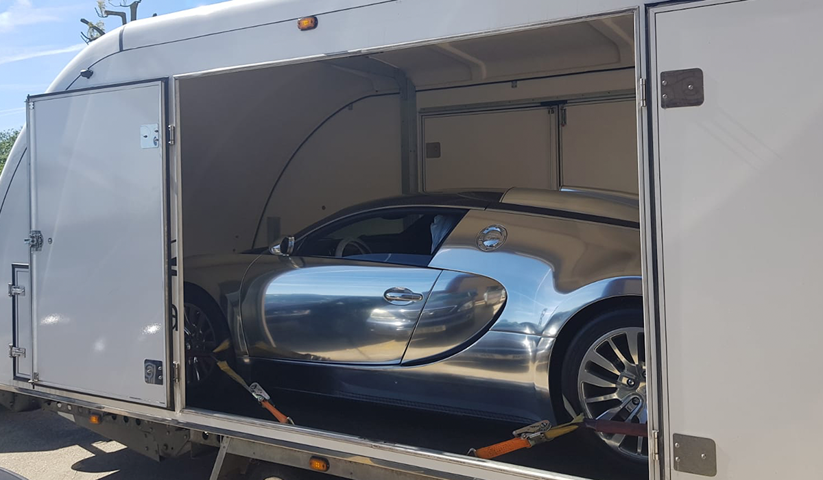 BSM Covered Enclosed Car Transport London England Mirror Bugatti Veyron