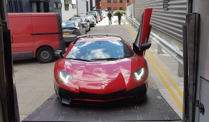 BSM Covered Enclosed Car Transport London England Red Lambo Cover