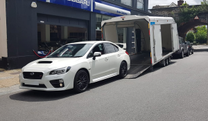 BSM Covered Enclosed Car Transport London England Subaru Racing