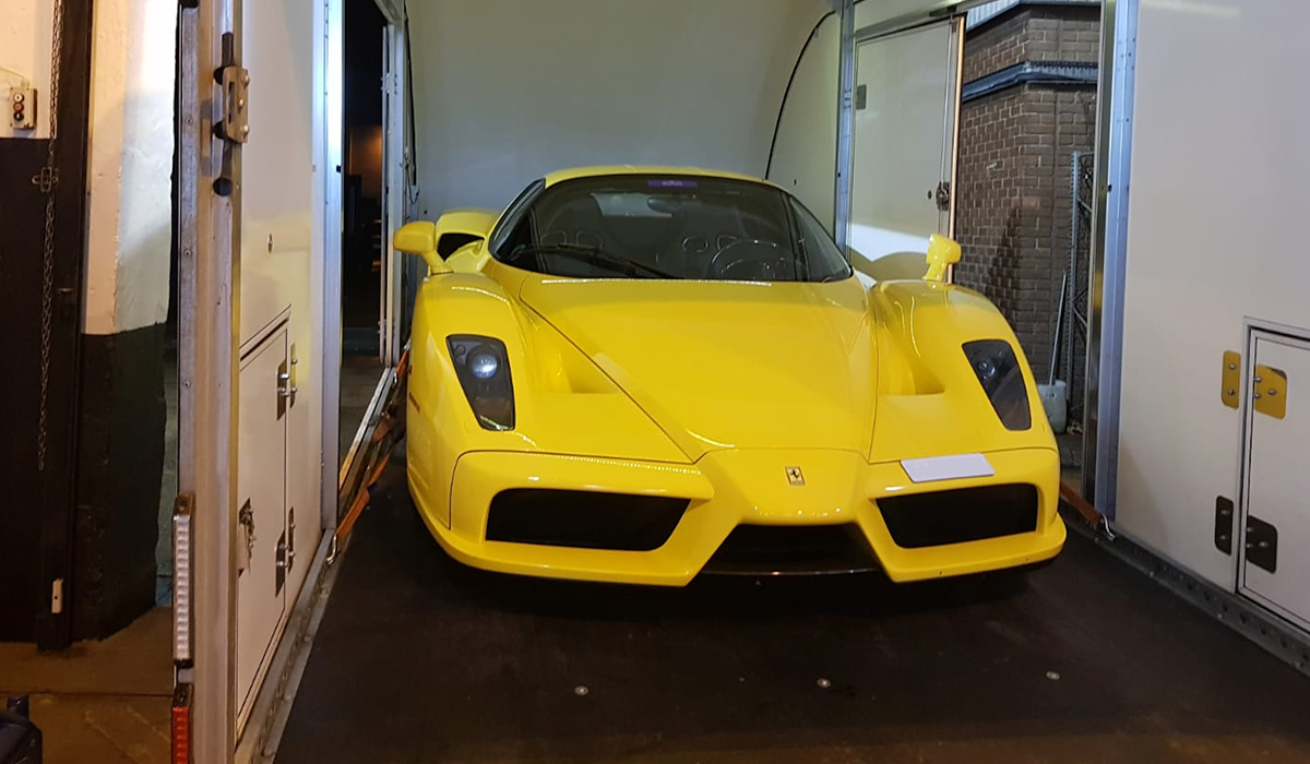 BSM Covered Enclosed Car Transport London England Yellow Ferrari Race