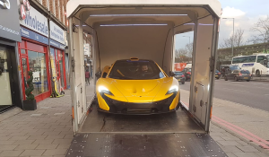 BSM Covered Enclosed Car Transport London England Yellow McLaren